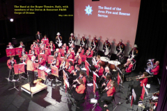 The Band on stage at the Roper Theatre, Bath, with the Devon & Somerset Corps of Drums in background.